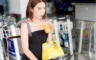 'Nàng dâu hỗn láo' Thúy Ngân mặc sành điệu ở sân bay