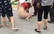 Xôn xao hình ảnh cô gái trẻ bị túm tóclột quần áo ngay giữa đường nghi do ghen tuông