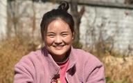 Bà mẹ Trung Quốc nổi tiếng nhờ bức ảnh ở ga tàu 11 năm trước