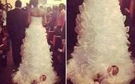 Phẫn nộ cô dâu gắn con gái sơ sinh vào đuôi váy cưới