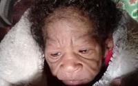 Bé sơ sinh có khuôn mặt già hơn mẹ