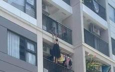 Hà Nội: Giận chồng, vợ treo mình lơ lửng ngoài ban công chung cư cao tầng