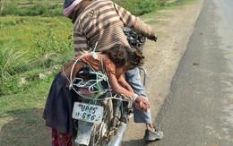Nữ sinh bị cha trói vào xe máy chở đến trường