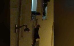 Bà bầu lơ lửng trên cửa sổ trốn kẻ khủng bố ở Paris