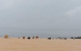 Nước lũ cuốn trôi người phụ nữ ở Quảng Bình