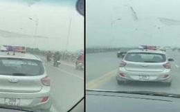 Tài xế taxi nghênh ngang cản đường xe cấp cứu trên cầu Vĩnh Tuy