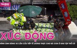 TP.HCM: Xúc động hình ảnh dùng xe cẩu tiếp tế cho người dân ở chung cư cũ